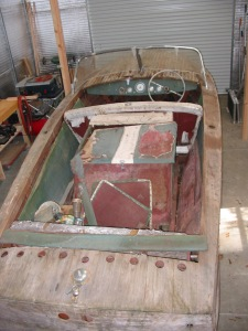The '59 Century pre-restoration with the engine cover and front bench still in.